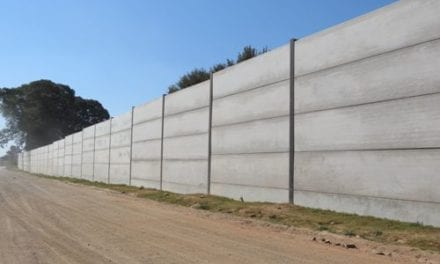 High-strength security wall using pre-stressed hollow-core slabs