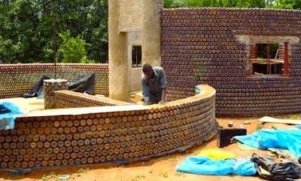 Building houses from plastic bottles