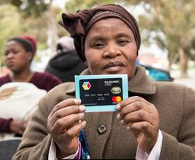 Langa resident with PACKA-CHING card