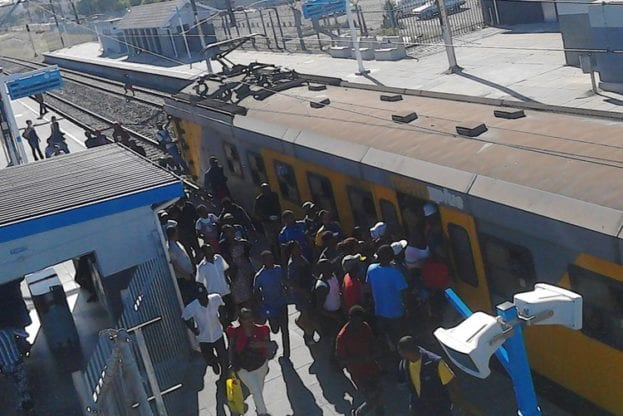 This train at Parow Station on Thursday was so full, that many people on the platform could not board it. Photo: Tariro Washinyira