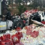 Looters milk crashed dairy trucks