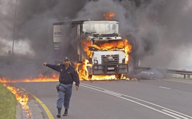 Three truck unions agree to adjust wage demands