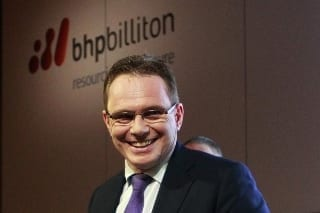 BHP Billiton reports drop in half-year profit & cuts spending