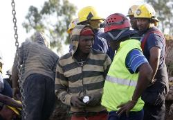 Police hunt for killers of eight illegal miners