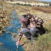 Van Wyk tests water in a run-off canal in Soweto. Image: Melusi Nkomo