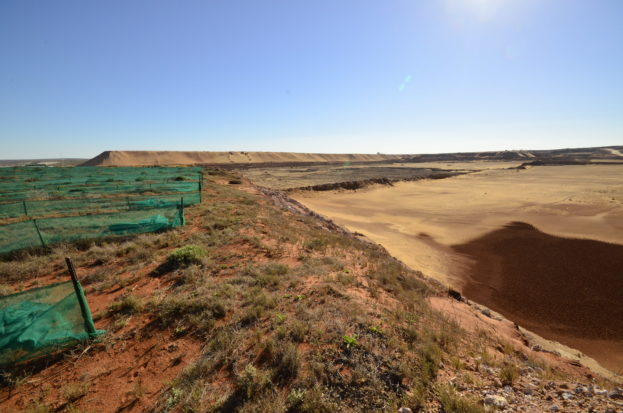 A mined out site under rehabilitation (left) adjacent to an active open cast pit (right)