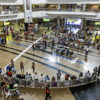 South Africa, Johannesburg, O. R. Tambo International Airport, terminal concourse area passengers overhead view. (Photo by: Jeffrey Greenberg/UIG via Getty Images)